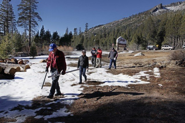 Picture of Scientists Measuring Snow Packs