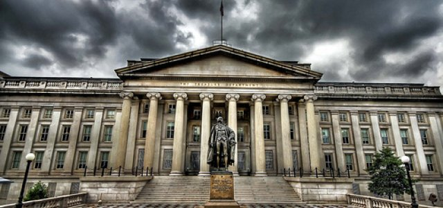 Picture of U.S. Treasury Building framed by threatening skies